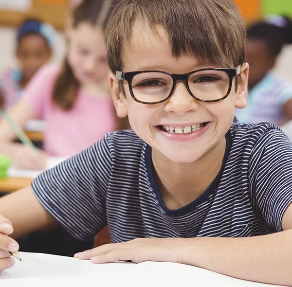 Boy Smiling in the classroom