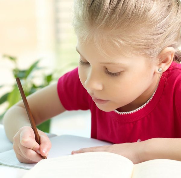 Girl in Red Shirt Doing Homework