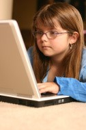 Girl with Glasses on Laptop